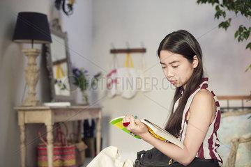 Woman reading novel at home