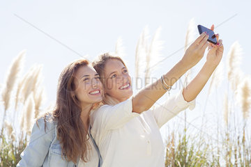 Friends pausing for selfie during road trip