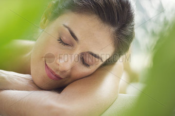 Woman resting head on arms