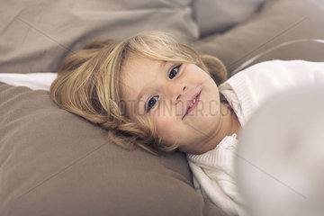Little girl relaxing at home