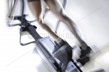 Woman exercising on stair climber