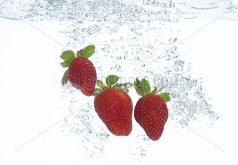 Strawberries submerged in water