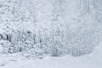 Frozen waterfall base  Skogafoss  Skogar  Iceland
