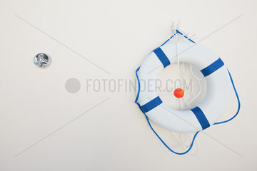 Life preserver hanging on wall