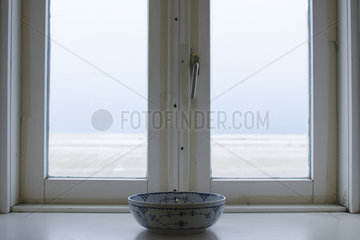 Ceramic bowl in front of window