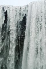 Frozen Skogafoss waterfall  Skogar  Iceland