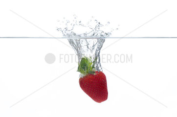 Strawberry splashing into water