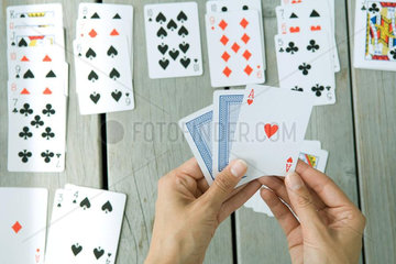 Woman playing card game  cropped view of hands