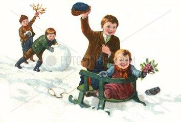 Kinder fahren Schlitten  um 1929