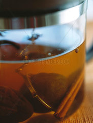 Tea strainer steeping in glass