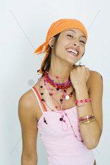 Teenage girl wearing bandana  smiling at camera  portrait