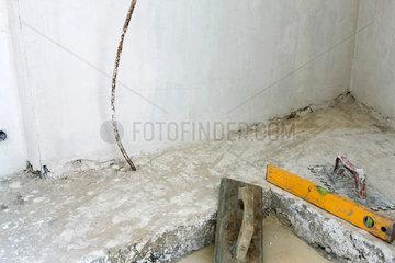 Masonry trowel  level near wet cement