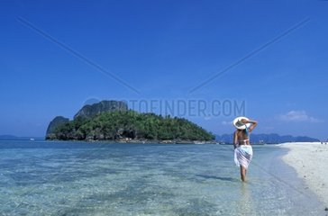 Thailand  Andaman Sea Krabi Koh Mor Island  woman walking on the beach