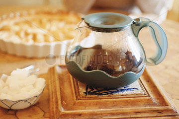 Coffee pot and sugar cubes