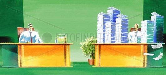 Employee in office with a stack of paperworks in front of his colleague with empty desk