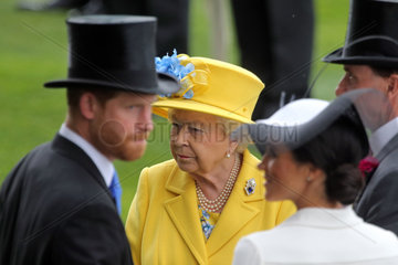 Royal Ascot  Portrait of HRH Queen Elizabeth the Second behind TRH Harry the Duke of Sussex and TRH Meghan the Duchess of Sussex