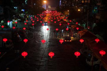 Yangon  Myanmar  Lampions haengen ueber einer Strasse in Chinatown
