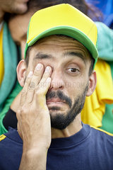 Football supporter crying at match