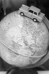 Berlin  Deutschland  Trabant als Modellauto auf einem Globus