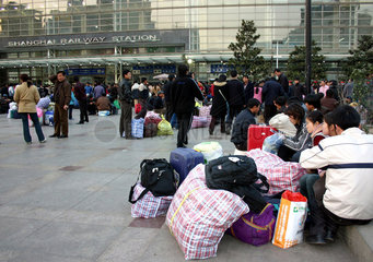 Travelers at the Shanghai Railway station