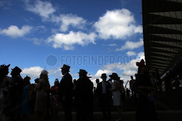 Royal Ascot  Fashion  audience with hats silhouetted against the sky