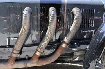 Aufpuffkr_mmmer eines Mercedes SLK  30er Jahre