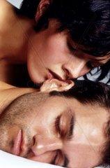 Couple close up  woman kissing man sleeping
