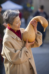 Woman Shopping For Pumpkins At Public Market. (Photo by: Education Images/UIG)