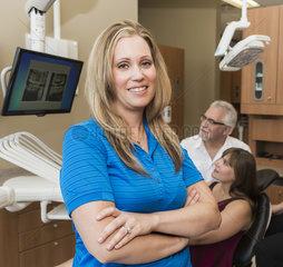 Dental assistant posing during dental consultation with patient; Edmonton  Alberta  Canada