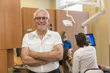 Dentist posing during patient consultation; Edmonton  Alberta  Canada