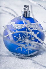 Blue bauble in snow