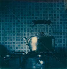 Teekanne auf einem Gasherd