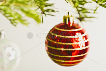 Christmas baubles hanging from Christmas tree  out of focus