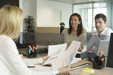 Business associates meeting in office
