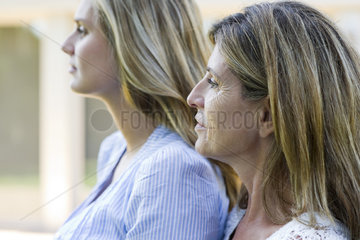 Mother and grown-up daughter  side view