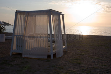 Beach gazebo at sunset