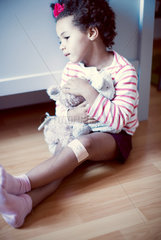 Little girl holding stuffed toy