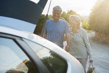 Senior couple loading car
