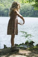 Girl watering plant