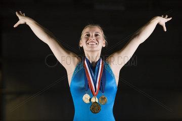 Female gymnastic medalist taking bow  portrait