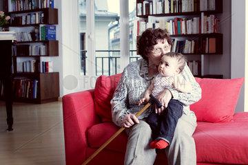 Grandmother kissing granddaughter  portrait