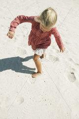 Girl playing on beach  high angle view