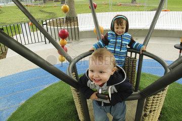 Toddler boys playing on playground