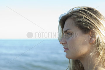 Woman looking at view  side view
