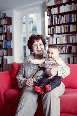 Grandmother holding baby granddaughter  portrait