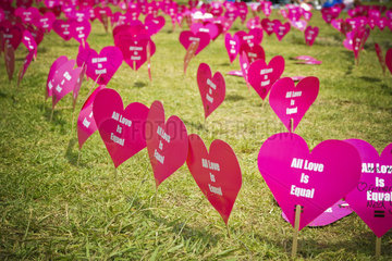 Heart shaped signs printed with the message all love is equal