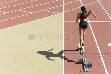 Female runner on track  rear view