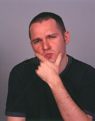 Man with hand on chin in thoughtful pose  December 2000.