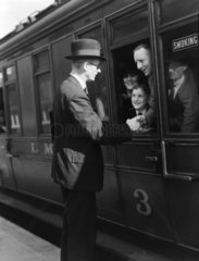 Passengers at a station  1937.