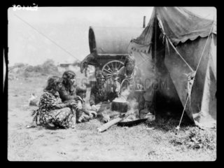 Romany group around a cooking fire  Epsom  Surrey  1935.